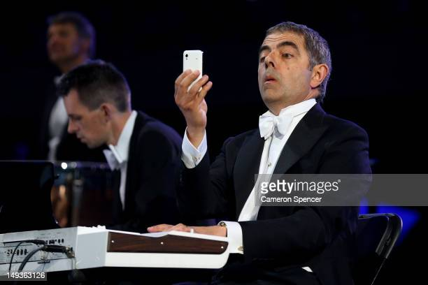 British actor Rowan Atkinson in his role as Mr Bean takes part in the Opening Ceremony of the London 2012 Olympic Games at the Olympic Stadium on...
