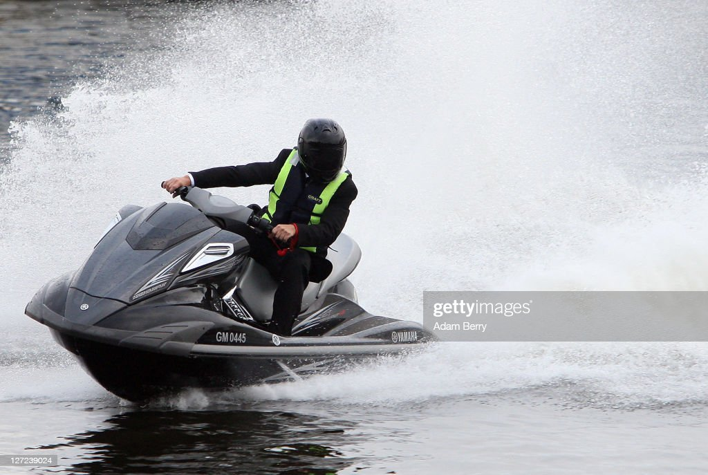 British Actor Rowan Atkinson rides a jet-ski on September 27, 2011 in Berlin, Germany. Atkinson was in Berlin to promote the German release of his James Bond parody's sequel, 'Johnny English - Jetzt Erst Recht' ('Johnny English Reborn'), in cinemas in the country from October 6. (Photo by Adam Berry/Getty Images).