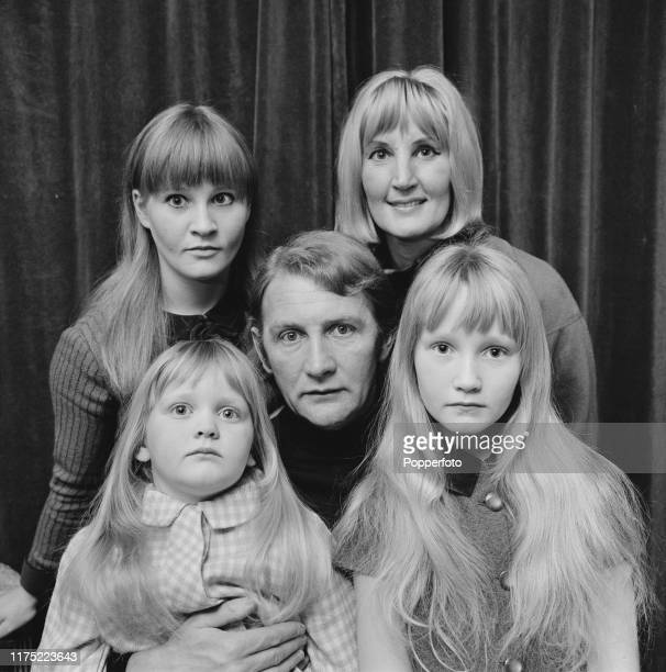 British actor Roy Dotrice posed with his wife Kay Dotrice and daughters Michele Yvette and Karen in March 1966