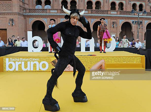 British actor Sacha Baron Cohen strikes a pose as he arrives dressed as a bull for the presentation of his new film 'Bruno' at Las Ventas bullring in...
