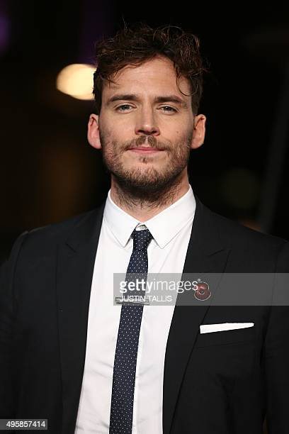 """British actor Sam Claflin arrives on the red carpet to attend the UK Premiere of the film """"The Hunger Games: Mockingjay Part 2"""" in central London on..."""