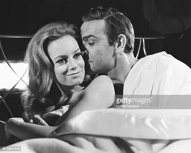 British actor Sean Connery films a love scene with Italian actress Luciana Paoluzzi during the making of 'Thunderball' at Pinewood Studios in England...