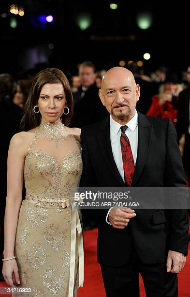 British actor Sir Ben Kingsley and his Brazilian wife Daniela Lavender pose as they arrive to attend a Royal Film Performance of Hugo in London...