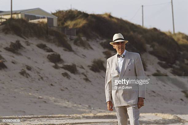 British actor Sir Christopher Lee stands on a Norfolk beach during a break in filming for an American Television series in Hemsby Norfolk UK circa...