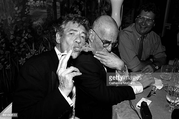 British Actor Sir Ian McKellen left blows cigarette smoke next to American playwright and gay rights activist Larry Kramer at a party at Tavern on...