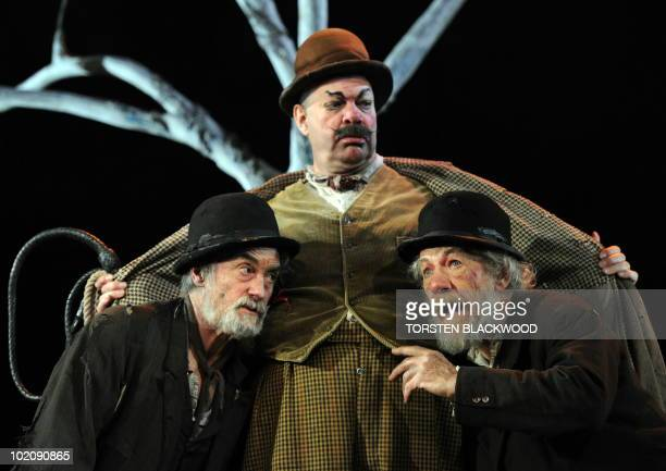 British actor Sir Ian McKellen plays the role of Estragon with Roger Rees as Vladimir and Matthew Kelly as Pozzo during the final rehearsal of Samuel...
