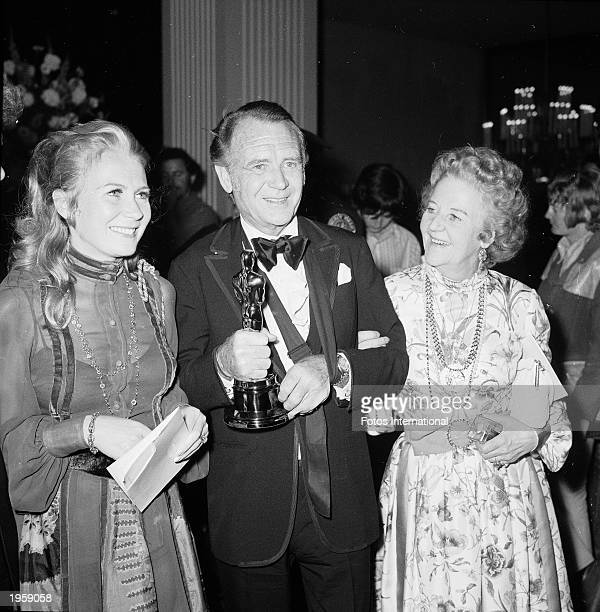 British actor Sir John Mills with his wife Mary and daugher Juliet at the Academy Awards Los Angeles April 15 1971 He holds his Oscar for Best...