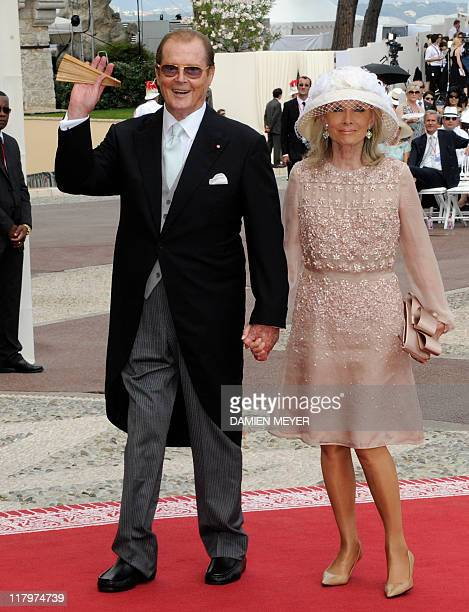 British actor Sir Roger Moore and his wife Kristina arrive for the religious wedding of Prince Albert II of Monaco and Princess Charlene of Monaco at...