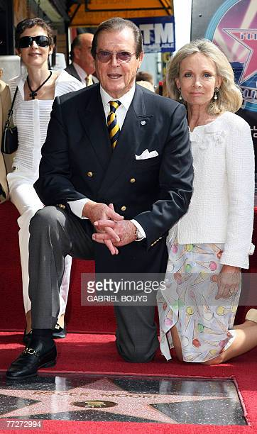 British actor Sir Roger Moore poses with his wife actress Christina Tholstrup and his daughter Deborah after being honored with a Star on the...