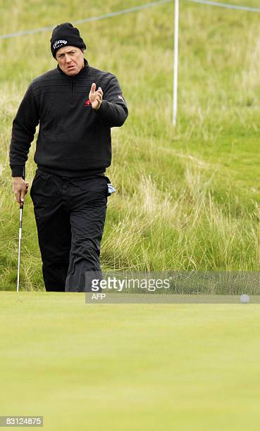 British actor star Hugh Grant gestures on the second hole of the Carnoustie golf course in Dundee on the third day of the Alfred Dunhill Links...