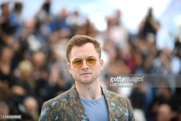 TOPSHOT British actor Taron Egerton poses during a photocall for the film Rocketman at the 72nd edition of the Cannes Film Festival in Cannes...