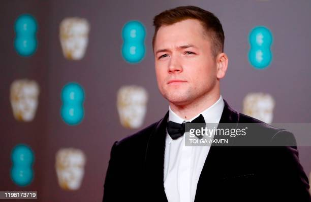 British actor Taron Egerton poses on the red carpet upon arrival at the BAFTA British Academy Film Awards at the Royal Albert Hall in London on...