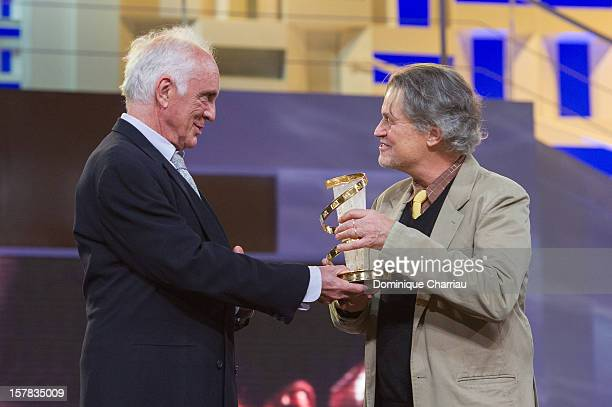 British actor Terence Stamp delivers a tribute award to US director Jonathan Demme during the 12th International Marrakech Film Festival on December...