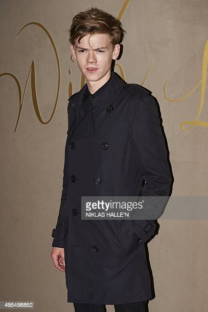 British actor Thomas BrodieSangster poses on arrival for the premiere of the Burberry festive film in London on November 3 2015 AFP PHOTO / NIKLAS...