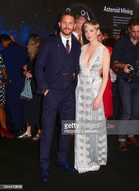 British actor Tom Hardy and actress Michelle Williams arrive for the premiere of 'Venom' at the Regency Village theatre in Westwood, California, on...