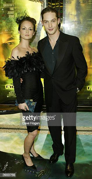 """British actor Tom Hardy and his girlfriend attend the UK film premiere of """"Star Trek Nemesis"""" at the Leicester Square Odeon on December 17, 2002 in..."""