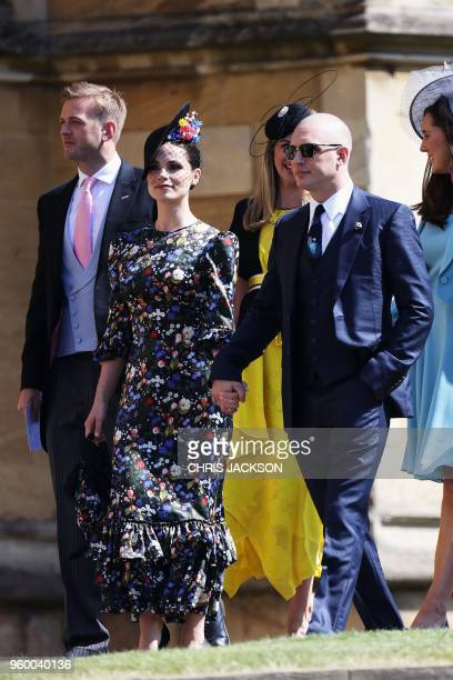British actor Tom Hardy and his wife Charlotte Riley arrive for the wedding ceremony of Britain's Prince Harry Duke of Sussex and US actress Meghan...