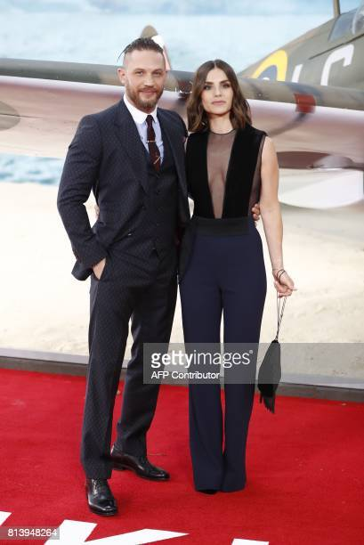British actor Tom Hardy and his wife Charlotte Riley pose for a photograph upon arrival for the world premiere of 'Dunkirk' in London on July 13 2017...
