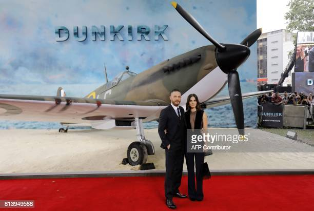 British actor Tom Hardy and his wife Charlotte Riley pose for a photograph upon arrival for the world premiere of Dunkirk in London on July 13 2017...