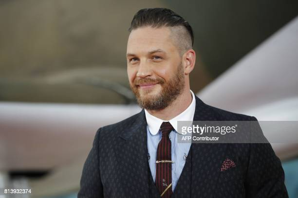 """British actor Tom Hardy poses for a photograph upon arrival for the world premiere of """"Dunkirk"""" in London on July 13, 2017. / AFP PHOTO / Tolga AKMEN"""