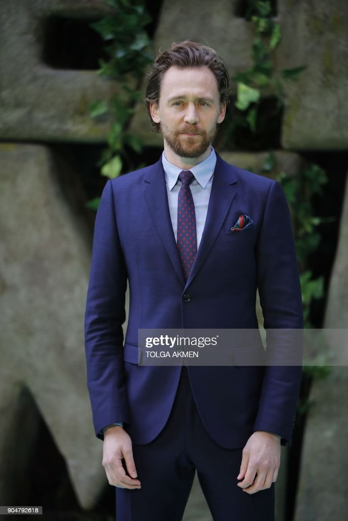 18d9bca0f23f7 British actor Tom Hiddleston poses on the carpet arriving to attend ...