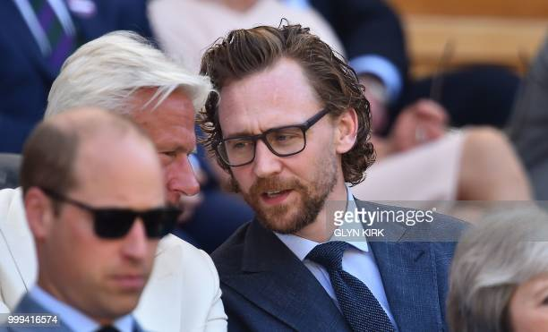 British actor Tom Hiddleston sits in the Royal Box before South Africa's Kevin Anderson plays Serbia's Novak Djokovic in their men's singles final...
