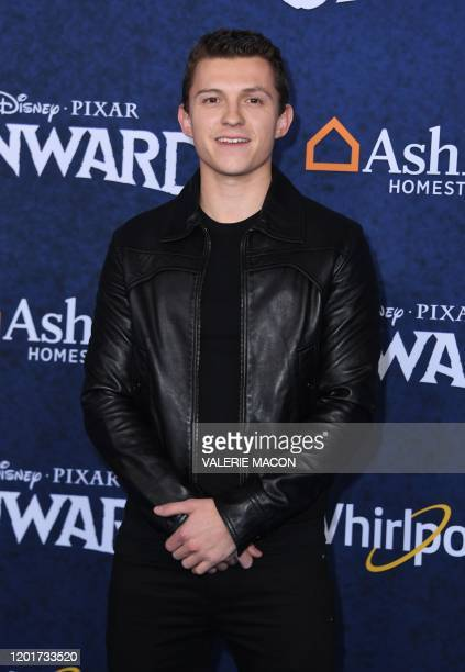 """British actor Tom Holland arrives for Disney Pixar's """"Onward"""" premiere at El Capitan theatre in Hollywood on February 18, 2020."""