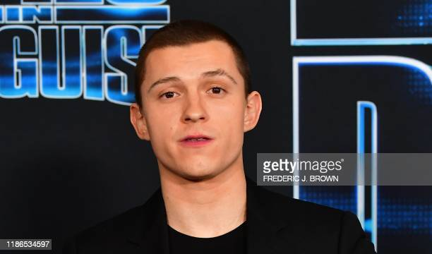 """British actor Tom Holland arrives for the """"Spies in Disguise"""" premiere at the El Capitan theatre in Hollywood on December 4, 2019."""