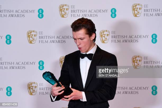 British actor Tom Holland poses with the Rising Star award at the BAFTA British Academy Film Awards at the Royal Albert Hall in London on February 12...