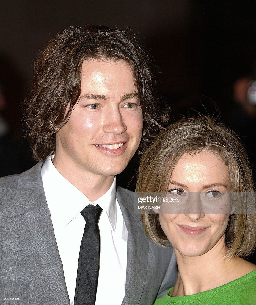 British actor Tom Wisdom and his partner Emma Lynley arrive at the ...