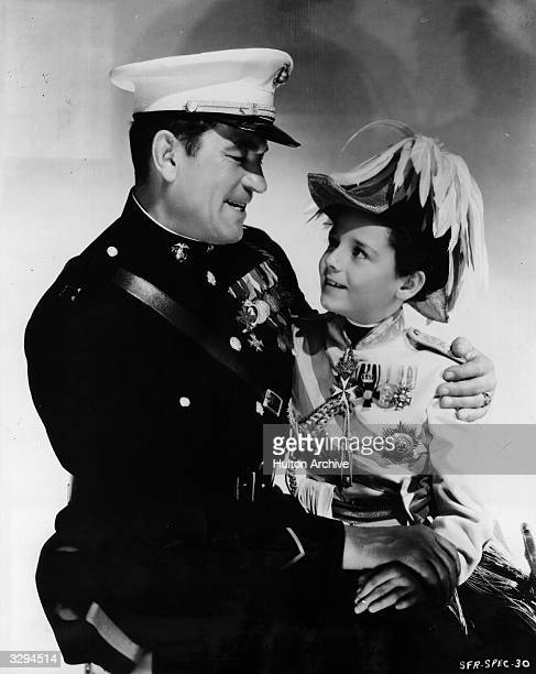 British actor Victor McLaglen shares an affectionate moment with child actor Freddie Bartholomew formerly Frederick Llewellyn in the film...