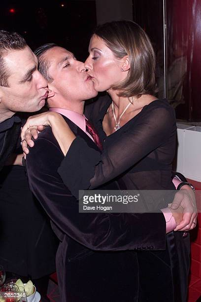 British actor Vinnie Jones Italian jockey Frankie Dettori and his wife attend the party for the film Mean Machine on December 18 2001 in London