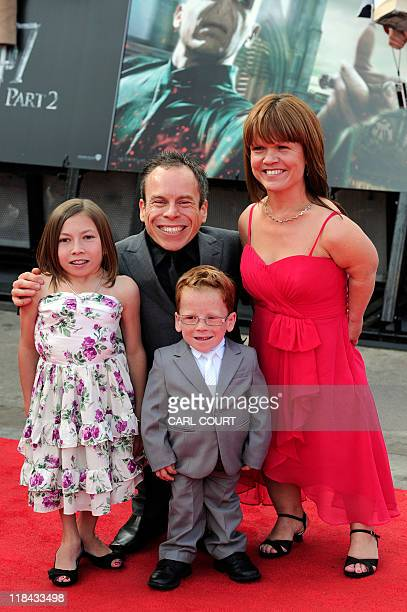 British actor Warwick Davis poses with wife Samantha and children Annabel and Harrison as they attend the world premiere of Harry Potter and the...