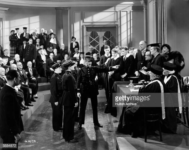 British actor Will Hay is accused by the French police of having stolen the Mona Lisa in a scene from the film 'Good Morning Boys' directed by Marcel...