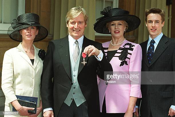 British Actor William Roache Mbe Outside Buckingham Palace after receiving his MBEWith his wife SARA his daughter VERITY and son WILLIAM