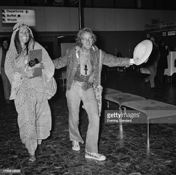 British actor, writer and comedian Marty Feldman with his wife Lauretta at the airport, UK, 10th April 1972.