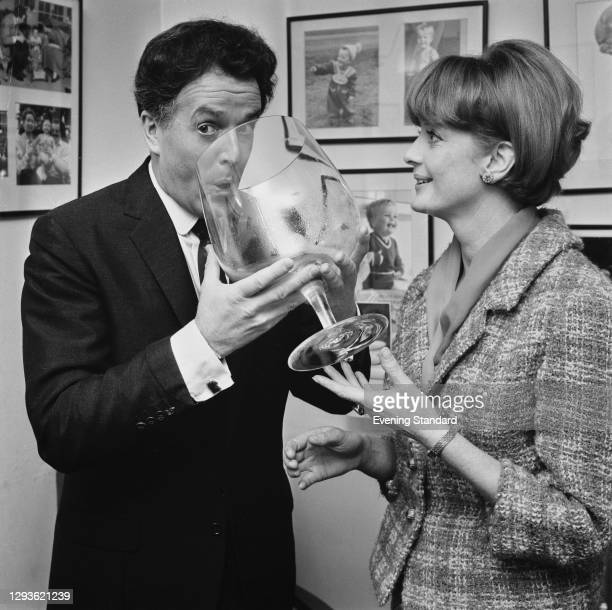 British actor-manager Brian Rix and his wife, Scottish actress Elspet Gray using an oversized brandy schooner, London, UK, March 1966.