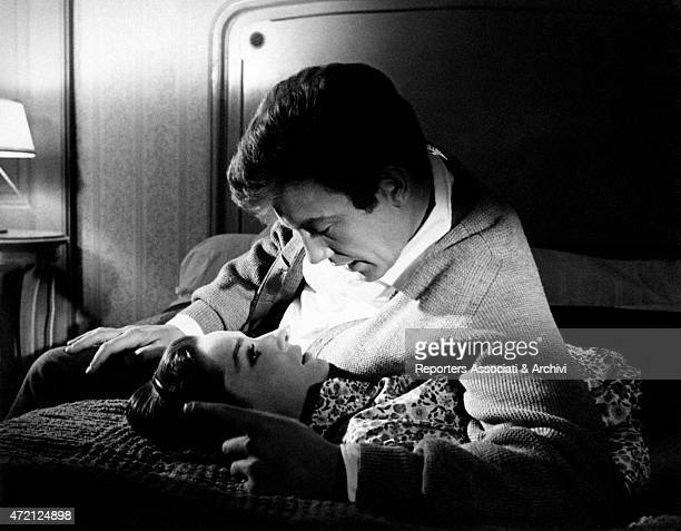 British actors Albert Finney and Audrey Hepburn lying on a bed talk romantically they're playing Mark and Johanna Wallace the couple at the center of...
