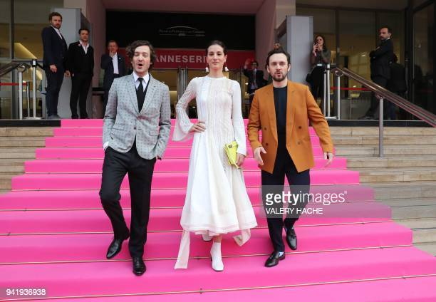 British actors Alexander Vlahos Elisa Lasowski and George Blagden of the 'Versailles' television series pose as they arrive for the opening of the...