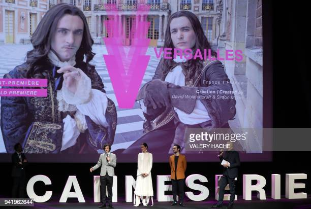 British actors Alexander Vlahos Elisa Lasowski and George Blagden speak on stage as journalist Laurent Weil looks on during the presentation of the...