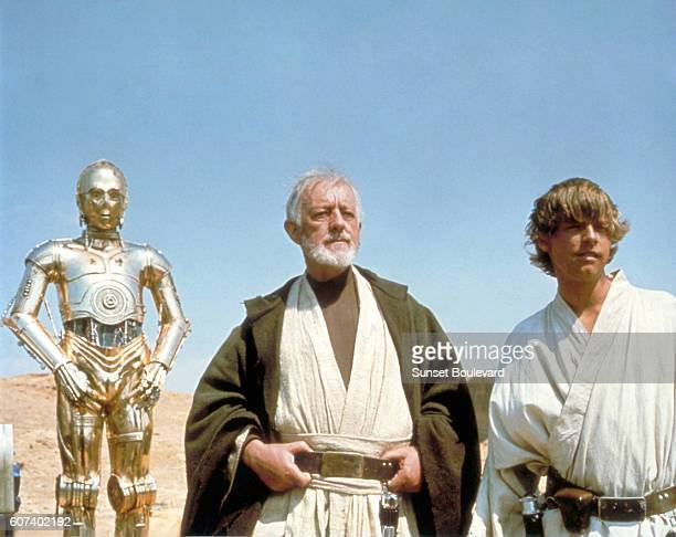British actors Anthony Daniels Alec Guinness and American Mark Hamill on the set of Star Wars Episode IV A New Hope written directed and produced by...