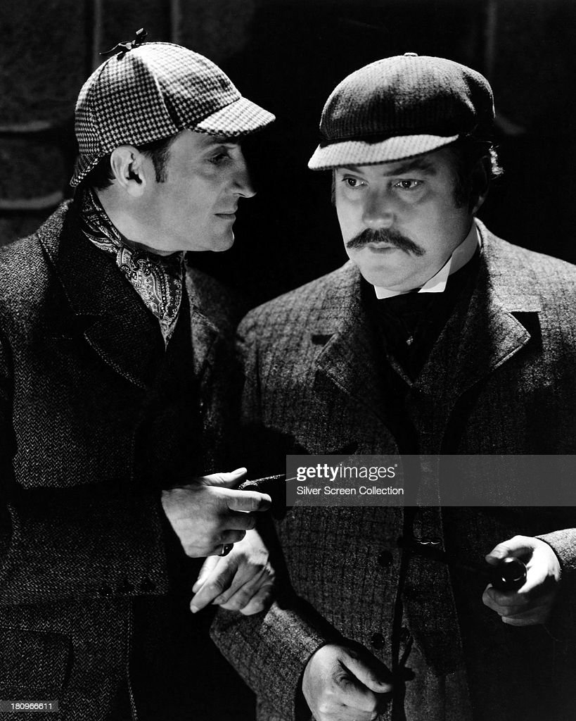 British actors Basil Rathbone (1892 - 1967, left), as Sherlock Holmes, and Nigel Bruce (1895 - 1953) as Doctor Watson, in 'The Hound of the Baskervilles', directed by Sidney Lanfield, 1939.