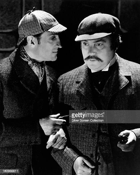 British actors Basil Rathbone as Sherlock Holmes and Nigel Bruce as Doctor Watson in 'The Hound of the Baskervilles' directed by Sidney Lanfield 1939