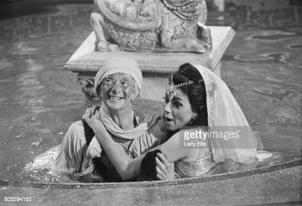 British actors Charles Hawtrey as 'Private James Widdle' and Carmen Dene on the set of comedy film 'Carry On Up the Khyber', UK, 9th May 1968.