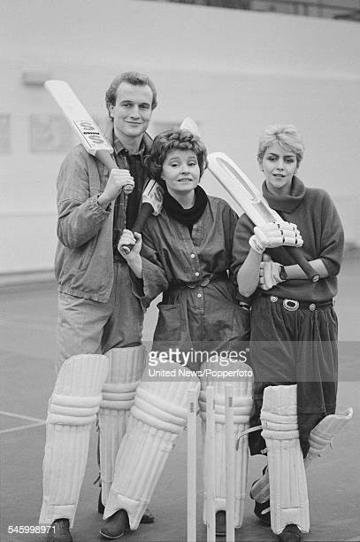 British actors Chris Humphreys Prunella Scales and Leslie Ash who all appear in the television film 'Outside Edge' pictured together wearing cricket...
