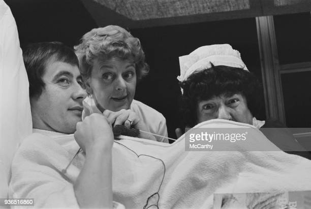 British actors Derek Fowlds Lally Bowers and Frank Middlemass on the set of play 'Spitting Image' UK 22nd October 1968