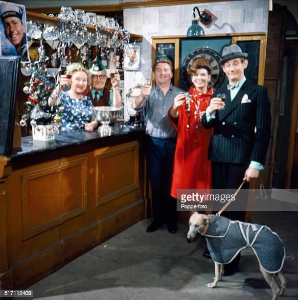British actors Doris Speed as Annie Walker Arthur Leslie as Jack Walker Peter Adamson as Len Fairclough and Pat Phoenix as Elsie Tanner on the set of...