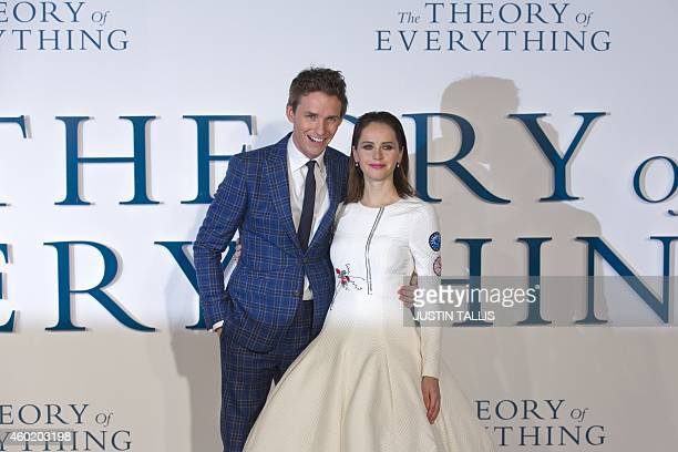 British actors Eddie Redmayne and Felicity Jones pose arriving at the UK premiere of the film 'The Theory of Everything' in London on December 9 2014...