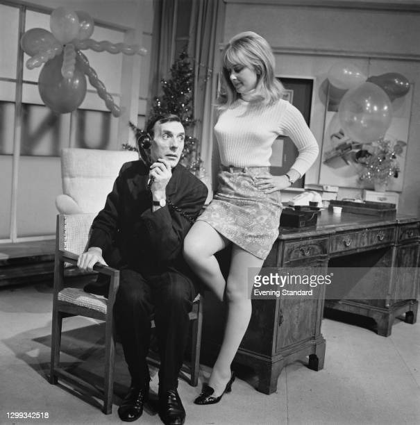 British actors Eric Sykes and Anna Carteret publicise their upcoming film, the British comedy 'The Plank', UK, October 1966.