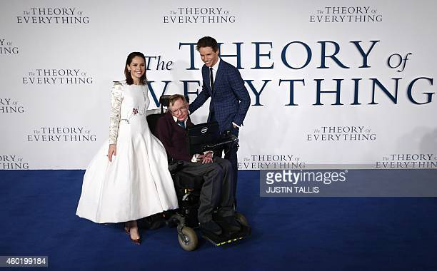 British actors Felicity Jones and Eddie Redmayne pose with British scientist Stephen Hawking at the UK premiere of the film 'The Theory of...
